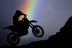 Motocross - silhouette with colorful rainbow Royalty Free Stock Image