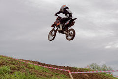 Motocross sports. Motorcycle racing cross country Royalty Free Stock Images