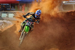 Motocross is taking a corner Royalty Free Stock Photos