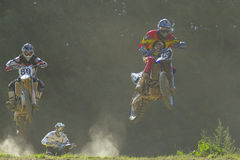 Motocross -three  jumping riders. ZAMBERK, CZECH REPUBLIC - JULY 09. An unidentified three motocross riders jumping in the Eastern Bohemia Cup motocross race on Stock Photos