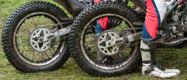 Motocross trial. Detail wheels motocross trial in panoramic view Stock Image