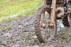 Motocross tyre in mud Stock Photo