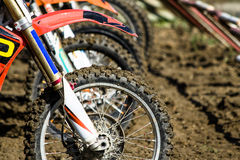 Motocross wheels start. Side view of motocross front wheels when preparing for start in competition Stock Photo