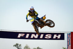 Motocross winner jump. When pass finish line stock image