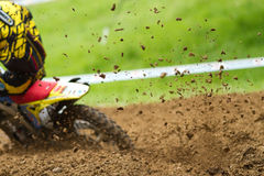 Motocrosser. Some mud in a motocross competition Royalty Free Stock Images