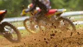 Motocrosser. Some mud in a motocross competition Stock Image
