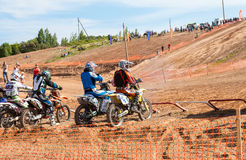 Motocrossers in the starting line waiting for race to start Royalty Free Stock Photography