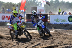 Motocrossruiters in nationaal ras Stock Foto