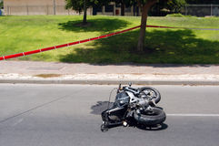 Motocycle Accident. A Motorbike accident on a road is taped off by police Royalty Free Stock Image