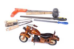 Motocycle made from wood with tools lik saw, file, hammer, chisel Stock Photos