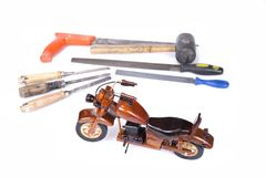 Motocycle made from wood with tools lik saw, file, hammer, chisel Stock Images