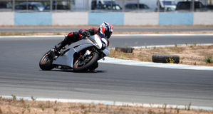 Motocycle racing. Man  riding his super speedy motocycle on the race track Stock Photography