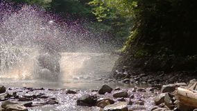 Motocycle Rider Crosses Mountain River stock footage