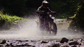 Motocycle Rider Crosses Mountain River archivi video