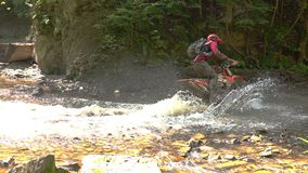 Motocycle Rider Crosses Mountain River stock video footage
