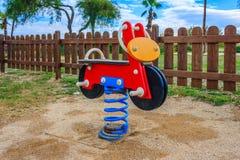 Motocyclette en parc d'enfants Images libres de droits