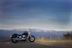 Motocyclette et paysage Photo stock