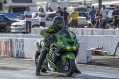 Motocyclette sur la voie Photographie stock libre de droits
