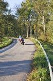 Motocyclette sur une route Images stock