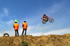 Motocyclist jumps Stock Images
