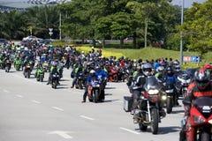 Motogp Biker Convoy. Image of a convoy of bikers attending the Malaysian MotoGP held at Sepang, Malaysia on 19 October, 2008 Royalty Free Stock Photos