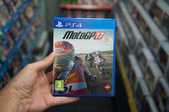 Motogp 17. Bratislava, Slovakia, june 15, 2017: Man holding Motogp 17 videogame on Playstation 4 console in store Stock Photos