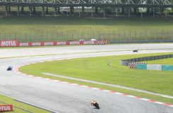 MotoGP rider's at cornering in action Stock Photography