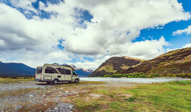 Motohome in New Zealand. Motorhome parked by river in the Southern Alps of New Zealand Royalty Free Stock Photo