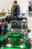 Motopark-2015 (BikePark-2015) Стойка выставки с ATVs Люди наблюдают ATV Стоковые Фотографии RF