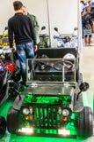 Motopark-2015 (BikePark-2015) Стойка выставки с ATVs Люди наблюдают ATV Стоковое Изображение RF