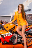 Motopark-2015 (BikePark-2015). Beautiful girl on sports bike near the stand with oils. Stock Images
