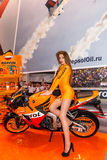 Motopark-2015 (BikePark-2015). Beautiful girl on sports bike near the stand with oils. Royalty Free Stock Photos