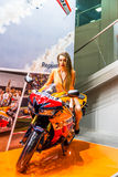 Motopark-2015 (BikePark-2015). Beautiful girl on sports bike near the stand with oils. Royalty Free Stock Image
