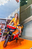 Motopark-2015 (BikePark-2015). Beautiful girl on sports bike near the stand with oils. Stock Photos