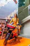 Motopark-2015 (BikePark-2015). Beautiful girl on sports bike near the stand with oils. Stock Photography