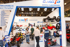 Motopark-2015 (BikePark-2015). The exhibition stand of C.Moto. Visitors are watching the stand. Stock Image