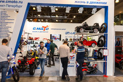 Motopark-2015 (BikePark-2015). The exhibition stand of C.Moto. Visitors are watching the stand. Royalty Free Stock Photos