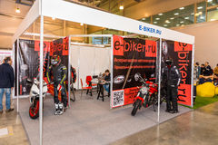 Motopark-2015 (BikePark-2015). The exhibition stand of the Internet shop of equipment E-biker. Royalty Free Stock Images