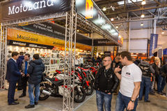Motopark-2015 (BikePark-2015). Exhibition stand of MotoLand.Visitors are communicating with representatives of the company. Royalty Free Stock Photo