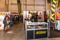 Motopark-2015 (BikePark-2015). The exhibition stand of the store of Moto gear Klim. Visitors of the exhibition. Royalty Free Stock Images