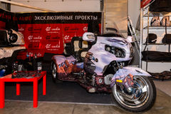 Motopark-2015 (BikePark-2015). The exhibition stand of the studio GL-Audio. Tricycle (Trike) Honda. Visitors are looking the stand Royalty Free Stock Photos