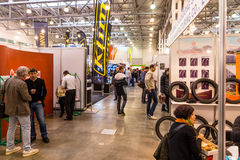 Motopark-2015 (BikePark-2015). The general view. Visitors of the exhibitions are looking stands. Winter 2015. Morning. Russia. Moscow. Crocus-Expo. Exhibition Stock Photo