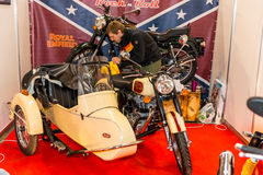 Motopark-2015 (BikePark-2015). Preparation for the exhibition. Man is wiping motorcycle (bike) with a stroller Royal Enfield. Royalty Free Stock Images