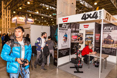 Motopark-2015 (BikePark-2015). The visitors are looking at stands. Stand of th ATV 4x4 Club. Winter 2015. Morning. Russia. Moscow. Crocus-Expo. Exhibition royalty free stock photos