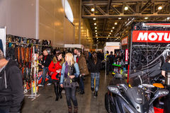 Motopark-2015 (BikePark-2015). Visitors are walking through the exhibition. They are watching  stands of the exhibition. Stock Photos
