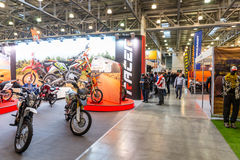 Motopark-2015. The overall look. People are walking in the hall and watching exhibition stands.  Stock Images