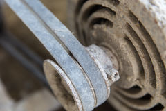 Motor,belt,rust,worn-out,black. Motor belts worn black and rust due to lack of care Royalty Free Stock Photography