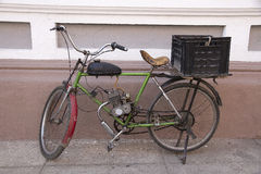 Motor bicycle parked in a street Stock Photography