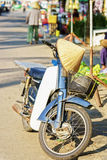 Motor bicycle in the street fruit and vegetable market stock photo