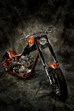 Motor bike against backdrop. Motor bike against gray and black backdrop Royalty Free Stock Photos